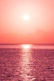 Beautiful tropical sunset ocean background Stock Photos