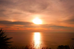 Beautiful Tropical Sunset Scene in the Sea. Phuket Lam Phromthep Royalty Free Stock Photo