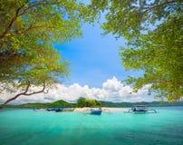 Beautiful tropical uninhabited island on background of green mou Stock Image
