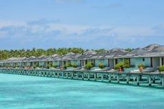 Beautiful tropical view with over water villas at the ocean. Beautiful tropical view with over water villas at the island at Maldives Stock Photos
