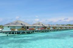 Beautiful tropical view with water villas at the ocean. Beautiful tropical view with water villas at the island at Maldives Royalty Free Stock Photography