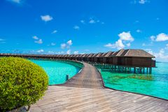 Beautiful tropical view of water villas on perfect Stock Photos