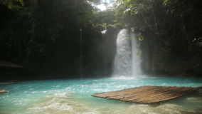 Beautiful tropical waterfall.Kawasan Falls. Waterfall in the jungle.tropical rain forest with waterfall.Waterfall with natural swimming pool in a mountain river stock video footage