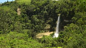 Beautiful tropical waterfall. Philippines Bohol island. Tropical waterfall in green forest in jungle. Waterfall with natural swimming pool in a mountain river stock footage