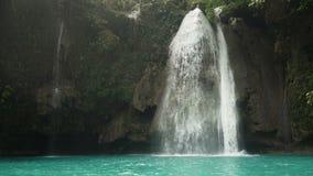 Beautiful tropical waterfall. Philippines Cebu island. Beautiful waterfall in green forest in jungle. Kawasan Falls. Waterfall in the mountains. Tropical rain stock video