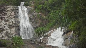 Beautiful tropical waterfall slow motion video. Clip stock video