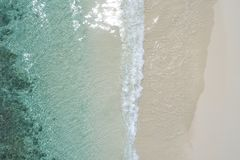 Beautiful tropical white empty beach and sea waves seen from above. Seychelles beach aerial view stock photo