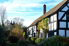 Beautiful tudor black and white house in English countryside. On sunny autumn day Royalty Free Stock Photography