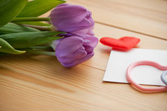 Beautiful tulip bouquet with hearts-symbols Stock Photo
