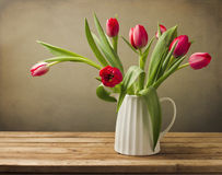 Beautiful tulip flower bouquet. On wooden table Royalty Free Stock Images