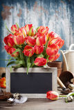 Beautiful tulips bouquet, easter eggs  and garden tools on woode Royalty Free Stock Photography
