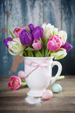 Beautiful tulips bouquet and easter eggs  on wooden table Royalty Free Stock Photo
