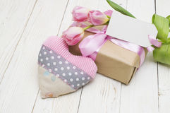 Beautiful tulips with gift box. happy mothers day, romantic still life, fresh flowers. On wooden background royalty free stock image