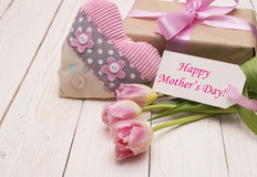 Beautiful tulips with gift box. happy mothers day, romantic still life, fresh flowers. On wooden background stock photo