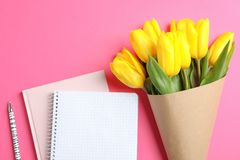 Beautiful tulips with notebooks for Mother`s Day on light background, top view. Space for text stock images