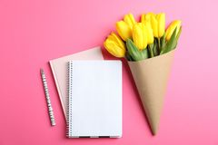 Beautiful tulips with notebooks for Mother`s Day on light background, top view. Space for text stock image