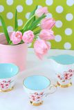 Beautiful tulips in a pink vase Royalty Free Stock Images