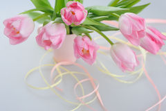 Beautiful tulips in a vase with decorative paper Royalty Free Stock Images