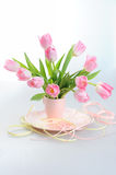 Beautiful tulips in a vase with decorative paper Royalty Free Stock Photography