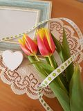 Beautiful Tulips With A Vintage Frame. Tulips with a vintage frame laying on a wooden background, Love, Friendship, Mothers day, Romance, Saying thank you stock photos