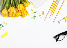 Beautiful tulips and yellow colored objects Royalty Free Stock Image