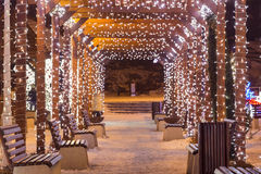 Beautiful tunnel of lights with snow in the winter time. Beautiful tunnel of lights with snow in the winter time Royalty Free Stock Photo