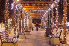 Beautiful tunnel of lights with snow in the winter time. Beautiful tunnel of lights with snow in the winter time Stock Photo
