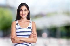 Beautiful turkish woman with crossed arms in a summer shirt royalty free stock image