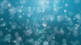 Beautiful turquoise blue bokeh background. Beautiful glowing dark turquoise blue bokeh background with floating light particles stock video footage