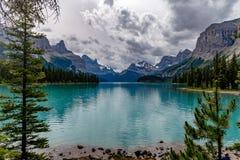 Maligne Lake, Canada. The beautiful turquoise blue of Maligne Lake, Canada with the mountains in the background royalty free stock photos