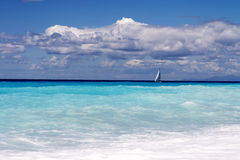 Beautiful turquoise blue sea background with boat Stock Images