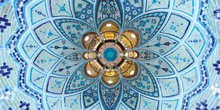 Beautiful turquoise geometric architecture patterns on ceiling of Middle East traditional bath house in Kashan, Iran Stock Images