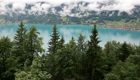 Beautiful turquoise lake Brienz in alpine mist Royalty Free Stock Photography