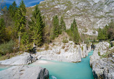 Beautiful turquoise mountain river. Soca. (Isonzo) river, Julian Alps, Slovenia. Popular tourist destination Royalty Free Stock Photography