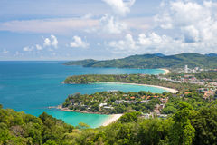Beautiful turquoise ocean waves with boats and coastline from high view point. Kata and Karon beaches Stock Images