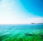 Beautiful Turquoise Sea with Blue Sky and Clouds. Stock Photos