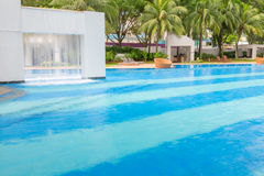 Beautiful turquoise swimming pool with large white structure of Stock Image