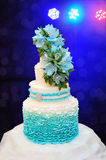 Beautiful turquoise three-tiered wedding cake Royalty Free Stock Photography