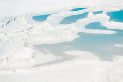 Beautiful turquoise water on snowy mountain. In Pamukkale Royalty Free Stock Image