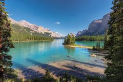 Scenic view on Spirit Island in Maligne Lake, Jasper National Park, Alberta, Canada. Beautiful turquoise waters of the Maligne Lake and Spirit Island  at sunset Royalty Free Stock Image