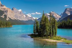 Scenic view on Spirit Island in Maligne Lake, Jasper National Park, Alberta, Canada. Beautiful turquoise waters of the Maligne Lake and Spirit Island  at sunset Royalty Free Stock Photos