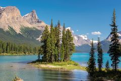 Scenic view on Spirit Island in Maligne Lake, Jasper National Park, Alberta, Canada. Beautiful turquoise waters of the Maligne Lake and Spirit Island  at sunset Stock Image