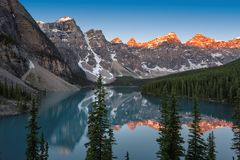 Rocky Mountains, Banff National Park, Canada. Beautiful turquoise waters of the Moraine Lake with snow-covered peaks above it in Rocky Mountains, Banff National Royalty Free Stock Photo