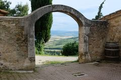 An old arch with the Tuscan countryside in the background stock photos
