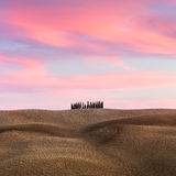 Beautiful Tuscany Landscape with hills and cypresses at sundown Royalty Free Stock Photos
