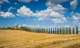 Beautiful Tuscany landscape with traditional farm house and dram Royalty Free Stock Photo