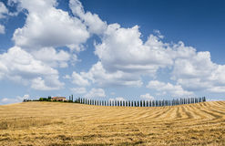 Beautiful Tuscany landscape with traditional farm house Royalty Free Stock Photo