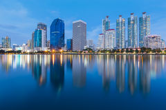 Beautiful twilight of city office water reflection Stock Photo