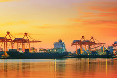 Beautiful twilight sky at shipping port use for vessel ,nautical import and export transport logistic industry stock photos