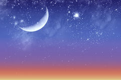 Beautiful twilight and starry sky. With the moon Stock Photo